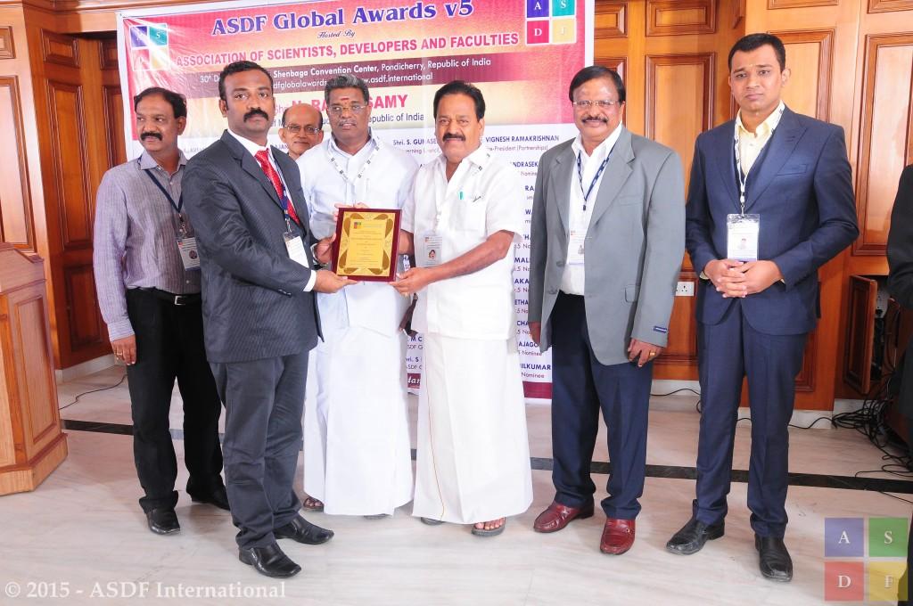 Balasubramian @ receiving awards 2015